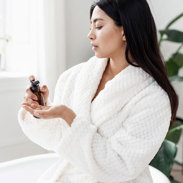 Woman using beauty product